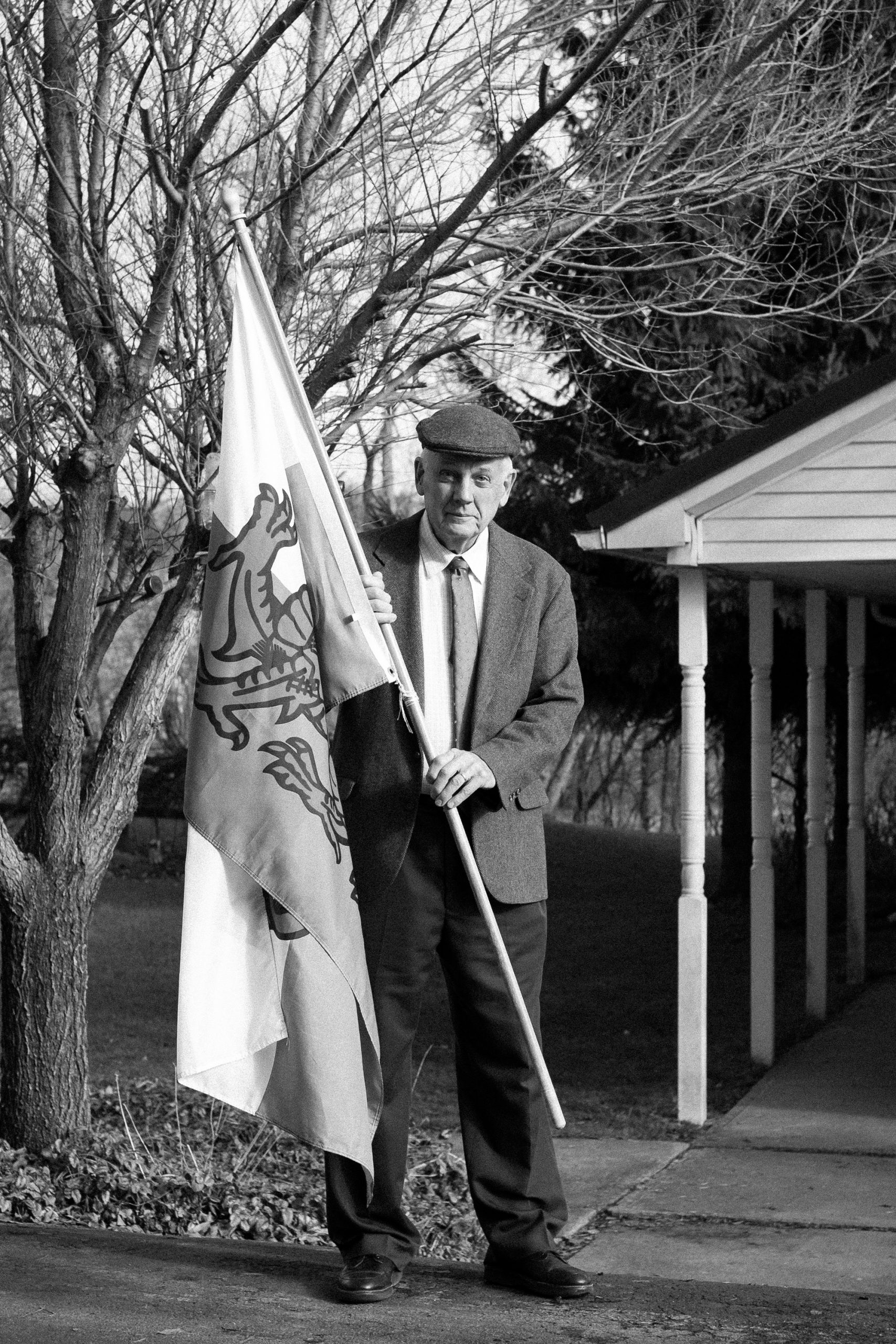 David Dudgeon, a member of the St. David's Society of Utica, poses with his Welsh flag outside his home in Herkimer, NY, USA.