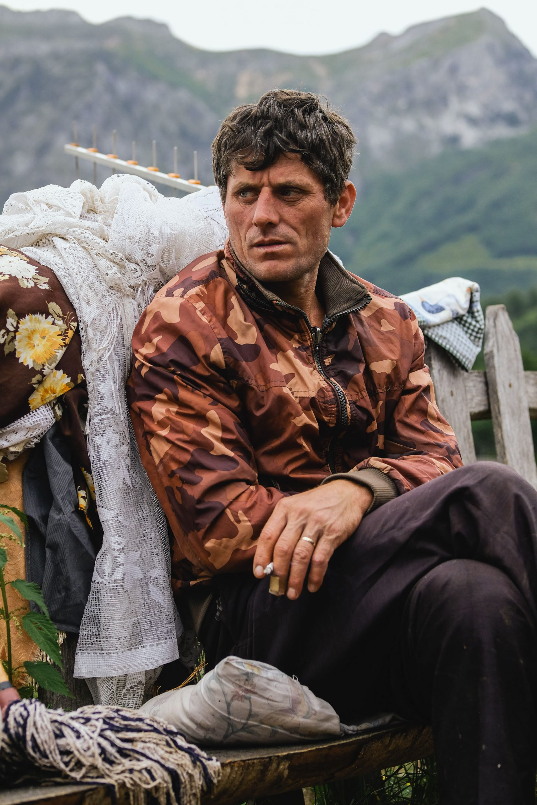 Gazmend Bikaj rests at his family's encampment in Koprisht, Kelmend region, Albania. During the summer he cares for a flock of sheep belonging to a farmer near the city if Shkoder, taking them to graze around pastures in the high alpine areas in Kelmend.